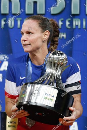Christie Rampone United States' Christie Rampone, receives the second place trophy after the final match of the International Women's Football Tournament against Brazil, at the National Stadium in Brasilia, Brazil