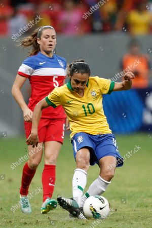 Marta Vieira, Christie Rampone Brazil's Marta Vieira, right, drives the ball from United States' Christie Rampone, left, during a final match of the International Women's Football Tournament at the National Stadium in Brasilia, Brazil