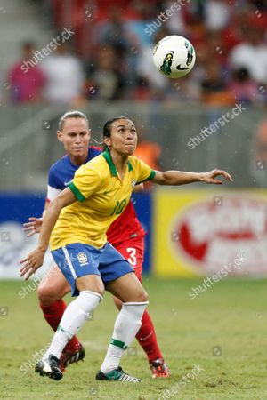 Marta Vieira, Christie Rampone Brazil's Marta Vieira, (10) fights for the ball with United States' Christie Rampone, back, (3) during a final match of the International Women's Football Tournament at the National Stadium in Brasilia, Brazil