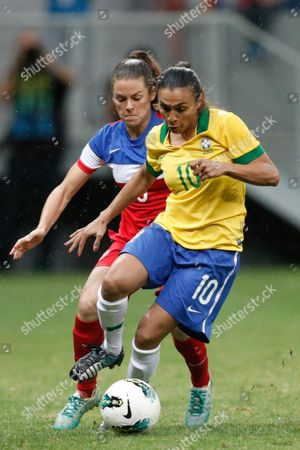 Marta Vieira, Christie Rampone Brazil's Marta Vieira, right, (10) fights for the ball with United States' Christie Rampone, during a final match of the International Women's Football Tournament at the National Stadium in Brasilia, Brazil