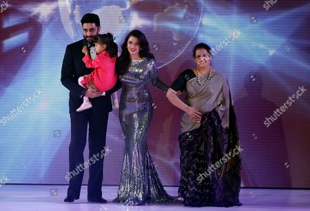 Indian actress Aishwarya Rai Bachchan, a former Miss World walks on the stage with husband Abhishek Bachchan and daughter Aaradhya, and mother Brindya, during the Miss World competition, at the ExCel centre in London