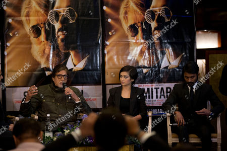 "Indian actors Amitabh Bachchan, left, Dhanush, right, and Akshara Haasan speak during a press conference to promote the movie ""Shamitabh"" at a hotel in London"