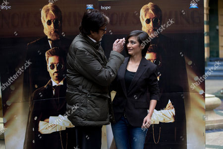 "Indian actors Amitabh Bachchan and Akshara Haasan pose for photographers during a photocall to promote the movie ""Shamitabh"" at a hotel in London"