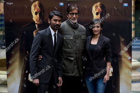 "Indian actors Amitabh Bachchan, center, Dhanush, left, and Akshara Haasan pose for photographers during a photocall to promote the movie ""Shamitabh"" at a hotel in London"