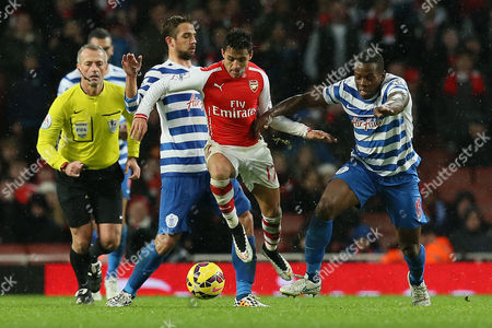 Arsenal's Alexis Sanchez, center, competes for the ball with Queens Park Rangers' Nico Kranjcar, left, and Nedium Onuoha during the English Premier League soccer match between Arsenal and Queens Park Rangers at the Emirates Stadium, London