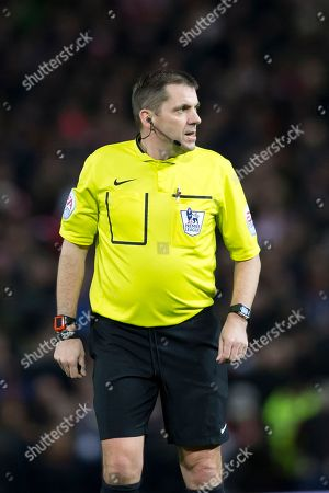 Referee Phil Dowd Referee Phil Dowd officiates during the English Premier League soccer match between Manchester United and Southampton at Old Trafford Stadium, Manchester, England