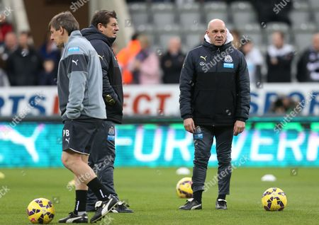 Newcastle United's assistant manager John Carver, center, Steve Stone, right, and Peter Beardsley, left, ahead of their English Premier League soccer match between Newcastle United and Burnley at St James' Park, Newcastle, England