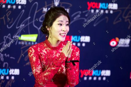 Stock Picture of Zhang Bichen Chinese singer Zhang Bichen gestures towards photographers at the red carpet for the Youku Gala Night held at the Water Cube in Beijing