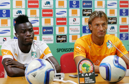 Ivory Coast Soccer player Eric Bertrand Bailly, left, and coach Herve Renard, right, attend a news conference ahead of their Group D Match on Saturday against Mali at Estadio De Malabo in Malabo, Equatorial Guinea