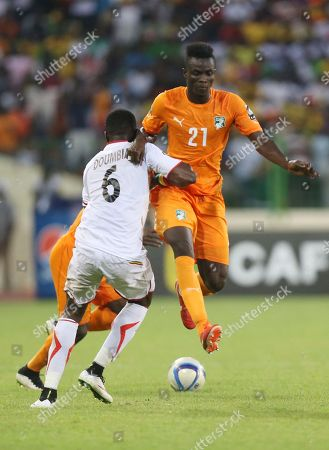 Stock Picture of Ivory Coast's Eric Bertrand Bailly, Right, is blocked by Mali's Tonga Doumbia during their African Cup of Nations Group D soccer match in Malabo, Equatorial Guinea