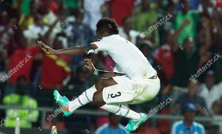 Ghana's Asamoah Gyan jumps over the advertising boards to celebrate his goal during the African Cup of Nations Group C soccer match against Algeria in Mongomo, Equatorial Guinea