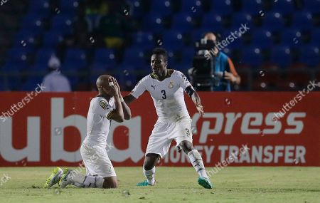 Ghana's Andre Ayew, left, celebrates with teammate Asamoah Gyan, right, after scoring a goal during their African Cup of Nations Group C soccer match in Mongomo, Equatorial Guinea