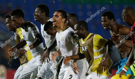 Ghana's Asamoah Gyan, third from left, with teammates celebrate after winning their African Cup of Nations Group C soccer match against South Africa in Mongomo, Equatorial Guinea