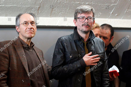 The new chief editor of French satirical magazine Charlie Hebdo, Gerard Biard, left, and Cartoonist Renald Luzier, known as Luz leave after a press conference in Paris, France, . Twelve people died when two masked gunmen assaulted the newspaper's offices on Jan. 7, including much of the editorial staff and two police. It was the beginning of three days of terror around Paris that saw 17 people killed before the three Islamic extremist attackers were gunned down by security forces. Charlie Hebdo had faced repeated threats for depictions of the prophet, and its editor and his police bodyguard were the first to die