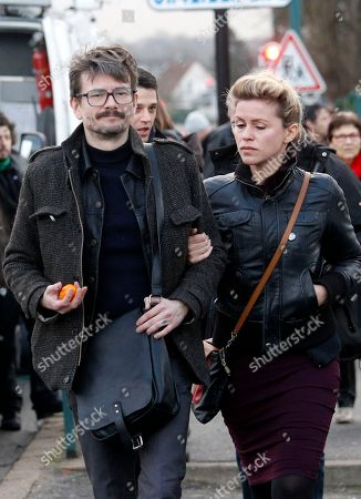 Cartoonist Renald Luzier, known as Luz, arrives for the funeral of Stephane Charbonnier, also known as Charb, the publishing director of Charlie Hebdo, in Pontoise, outside Paris, France, . The country is tense since 20 people, including three gunmen, were killed in last week's rampage. It began at the offices of satirical newspaper Charlie Hebdo, which is burying several staff members Thursday. Charlie Hebdo had been repeatedly threatened for caricatures of the Muslim prophet Muhammad