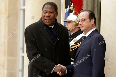 French President Francois Hollande welcomes Benin's President Yayi Boni at the Elysee Palace, Paris, . A rally of defiance and sorrow, protected by an unparalleled level of security, on Sunday will honor the 17 victims of three days of bloodshed in Paris that left France on alert for more violence