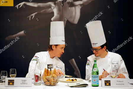"""Honorary President of the Bocuse d'Or Grant Achatz of the USA, left, tastes a dish with President of the international jury Thibaut Ruggeri of France, right, during the """"Bocuse d'Or"""" (Golden Bocuse) trophy, at the 15th World Cuisine contest, in Lyon, central France, . The contest, a sort of world cup of the cuisine, was started in 1987 by Lyon chef Paul Bocuse to reward young international culinary talents"""