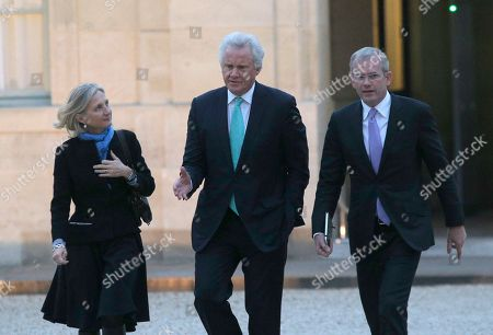General Electric Co. CEO Jeffrey R. Immelt, center, GE France chairwoman Clara Gaymard and Mark Hutchinson arrive for a meeting with France's President Francois Hollande, at the Elysee Palace in Paris, . GE agreed to buy the energy and power generation operations of the French engineering company Alstom for $17 billion