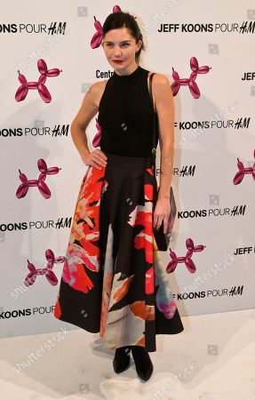Stock Picture of French actress Delphine Chaneac, poses during a photocall at Georges Pompidou museum in Paris, . Fashion house H&M launched a new leather hand bag in collaboration with American artist Jeff Koons, which features a printed design of his famous sculpture Balloon Dog (Magenta), 1994