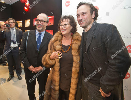 Andreas Kaufmann, owner and CEO of Leica Camera AG, left, Italian actress Claudia Cardinale, center, and Swiss actor and director Vincent Perez attends the opening of a Leica concept shop in Paris, . The first 35mm film Leica prototypes were built by Oskar Barnack at Ernst Leitz Optische Werke, Wetzlar, in 1913