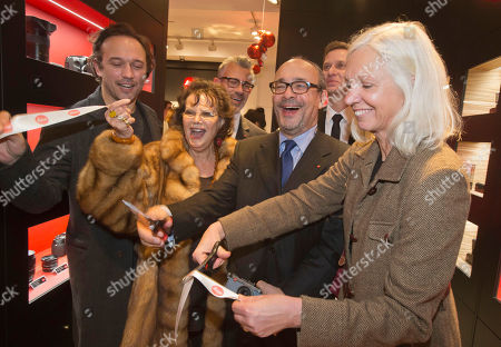 From left, Swiss actor and director Vincent Perez, Italian actress Claudia Cardinale, Andreas Kaufmann, owner and CEO of Leica Camera AG and assistant major of the Paris' 8th district Erika Duverger cut the ribbon during the opening of a Leica concept shop in Paris, . The first 35mm film Leica prototypes were built by Oskar Barnack at Ernst Leitz Optische Werke, Wetzlar, in 1913