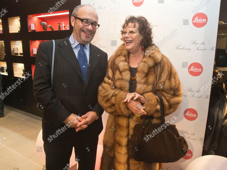 Stock Image of Andreas Kaufmann, owner and CEO of Leica Camera AG, left, and Italian actress Claudia Cardinale pose during the opening of a Leica concept shop in Paris, . The first 35mm film Leica prototypes were built by Oskar Barnack at Ernst Leitz Optische Werke, Wetzlar, in 1913