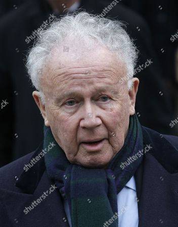 Stock Photo of French radio and television host Philippe Bouvard leaves the Saint Germain des Pres church after the funeral service of television host Jacques Chancel in Paris, France