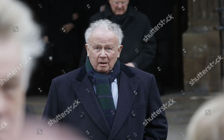 French radio and television host Philippe Bouvard leaves the Saint Germain des Pres church after the funeral service of television host Jacques Chancel in Paris, France