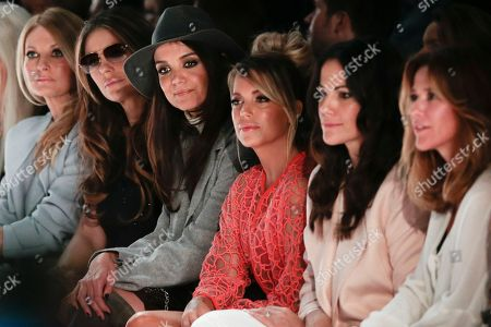 From left, German television presenter Frauke Ludowig, British actress Elizabeth Hurley, U.S. actress Katie Holmes, German Model Sylvie van der Vaart and German actresses Bettina Zimmermann and Alexandra Neldel watch the fashion show of Marc Cain's Fall - Winter 2015-2016 collection, as part of the Mercedes-Benz Fashion Week in Berlin