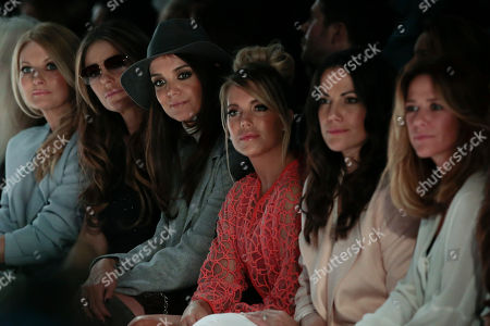 From left, German television presenter Frauke Ludowig, British actress Elizabeth Hurley, U.S. actress Katie Holmes, Dutch model Sylvie Meis and German actresses Bettina Zimmermann and Alexandra Neldel watch the fashion show of Marc Cain's Fall-Winter 2015-2016 collection as part of the Mercedes-Benz Fashion Week in Berlin, Germany