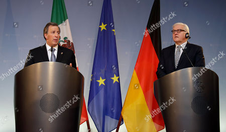 German Foreign Minister Frank-Walter Steinmeier, right, and his counterpart from Mexico Jose Antonio Meade Kuribrena, left, address the media during a joint press conference as part of a meeting in Berlin, Germany