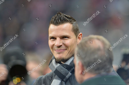 Stock Image of Bayern Daniel van Buyten smiles prior to the Champions League group E soccer match between FC Bayern Munich and CSKA Moscow in Munich, Germany