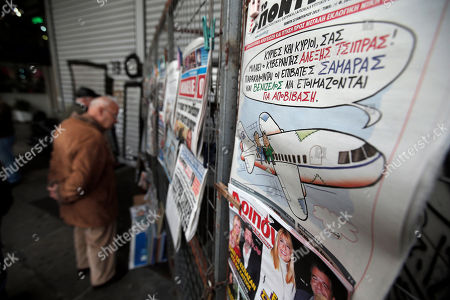A front page cartoon on a Greek weekly satirical newspaper depicts an airplane being flown by Alexis Tsipras, leader of Greece's Syriza left-wing main opposition party with the Greek Prime Minister Antonis Samaras' and conservative New Democracy party leader and Evangelos Venizelos, leader of PASOK socialist party, sitting on the wing, on a kiosk in central Athens, . The message by the 'pilot' reads in Greek: ' Ladies and gentlemen, this is captain Alexis Tsipras, passengers Samaras and Venizelos are asked to get ready to disembark