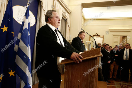 Nikos Kotzias, Evangelos Venizelos Greece's New Foreign Minister Nikos Kotzias, left, and outgoing counterpart Evangelos Venizelos make statements at a handover ceremony in Athens, . Greece's new left-wing government was sworn in Tuesday after a landmark general election victory at the weekend
