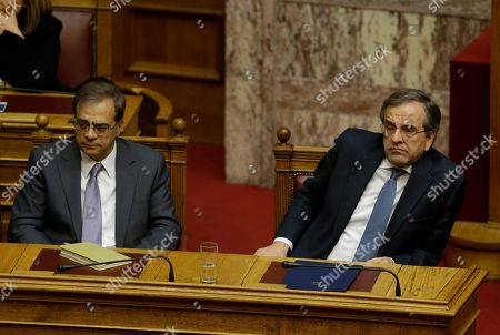 Antonis Samaras, Gikas Hardouvelis Greece's Prime Minister Antonis Samaras, right, and Finance Minister Gikas Hardouvelis attend the third round of voting to elect a new Greek president at the Parliament in Athens, as Greece heads to early general elections after parliament failed to elect a new president in a third and final round of voting. The coalition government's candidate for the post, the 73-year-old former European commissioner Stavros Dimas, garnered 168 votes from parliament's 300 seats, short of the 180 votes needed to win