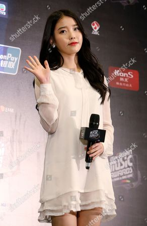 "IU South Korean singer Lee Ji-eun, also named ""IU"" poses for the photographers during the news conference of 2014 Mnet Asian Music Awards (MAMA) in Hong Kong . The Mnet Asian Music Awards is one of the major K-pop music award ceremonies"