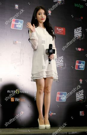 "IU South Korean singer Lee Ji-eun, also named ""IU"" poses during the news conference of 2014 Mnet Asian Music Awards (MAMA) in Hong Kong . The Mnet Asian Music Awards is one of the major K-pop music award ceremonies"