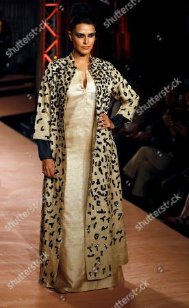 Neha Dhupia Bollywood actress Neha Dhupia displays a creation by Indian designers Abraham and Thakore during a fashion show in Bangalore, India