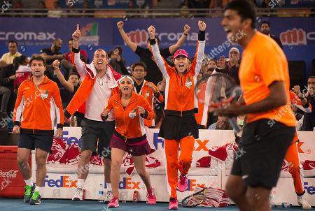 Micromax Indian Aces players from left, Fabrice Santoro, Cedric Pioline, Sania Mirza and Ana Ivanovic celebrate as their team members Gael Monfils, and Rohan Bopanna, right, beat Manila Mavericks players Treat Huey and Daniel Nestor, in men's double during International Premier Tennis League, in New Delhi, India