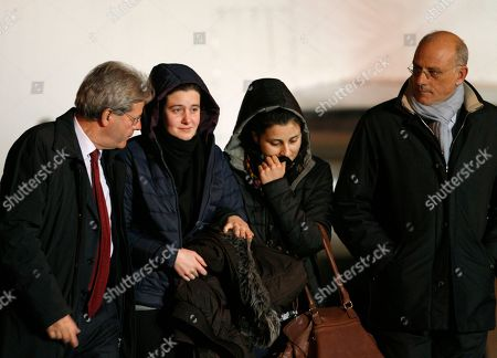 Paolo Gentiloni, Greta Ramelli, Vanessa Marzullo, Claudio Taffuri Italian aid workers, 21-year-old Greta Ramelli, second from left, and 20-year-old Vanessa Marzullo, second from right, are welcomed by Foreign Minister Paolo Gentiloni, left, and adviser Claudio Taffuri as they arrive at Ciampino's military airport, near Rome, early . The women, from the northern Lombardy region, disappeared in the northern Syrian province of Aleppo in late July or early August. It wasn't clear at the time who had taken them. They appeared in a video released earlier this month, asking the Italian government to help bring them home, with Ramelli saying they could be killed. Marzullo held a piece of paper with the date Dec. 17, 2014, written on it