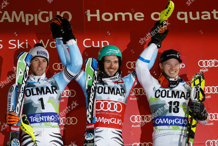 Felix Neureuther, Fritz Dopfer, Jens Byggmark Felix Neureuther, of Germany, center, winner of an alpine ski, men's World Cup slalom race, celebrates on the podium with second placed Germany's Fritz Dopfer, left, and third placed Jens Byggmark, of Sweden, in Madonna di Campiglio, Italy, . Felix Neureuther took advantage of soft snow conditions to win a World Cup slalom race Monday night and take the lead in the discipline standings from Austrian rival Marcel Hirscher, who was only seventh