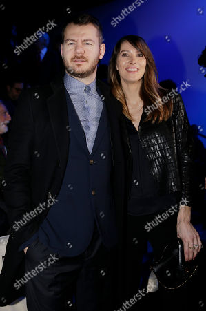 Alessandro Cattelan and his wife Ludovica Sauer attend the Giorgio Armani men's Fall-Winter 2015-2016 parade part of the Milan Fashion Week, unveiled in Milan, Italy