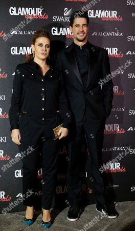 Francesca Versace is flanked by her Christopher Leoni as they attend the 2014 Glamour Awards event hosted by Glamour magazine in Milan, Italy