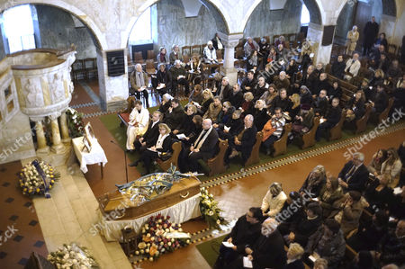 """People attend the funeral of Anita Ekberg in Rome, . Ekberg, the Swedish-born actress and sex-symbol of the 1950s and '60s who was immortalized bathing in the Trevi fountain in """"La Dolce Vita,"""" has died Sunday, Jan. 11, 2015. She was 83. Ekberg had long lived in Italy, the country that gave her worldwide fame thanks to the iconic dip opposite Marcello Mastroianni. The scene where the blond bombshell, clad in a black dress, her arms wide open, calls out """"Marcello"""" remains one of the most famous images in film history"""