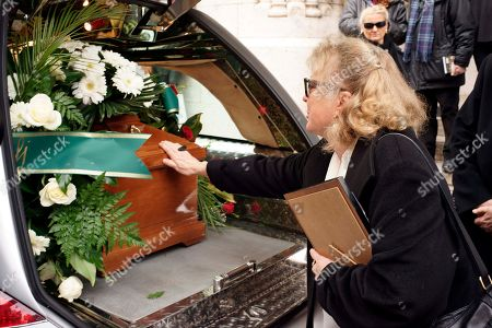 """Christina Ekberg Christina Ekberg, nephew of Swedish-born actress Anita Ekberg, touches her aunt's coffin at the end of the funeral in Rome, . Ekberg, the sex-symbol of the 1950s and '60s who was immortalized bathing in the Trevi fountain in """"La Dolce Vita,"""" has died Sunday, Jan. 11, 2015. She was 83. Ekberg had long lived in Italy, the country that gave her worldwide fame thanks to the iconic dip opposite Marcello Mastroianni. The scene where the blond bombshell, clad in a black dress, her arms wide open, calls out """"Marcello"""" remains one of the most famous images in film history"""