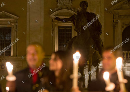 Stock Picture of People attend a torchlight procession at the Campidoglio, Capitol hill, in Rome, . Police arrested 37 people this week, including a reputed mobster with roots in far-right domestic terrorism, and notified former Rome Mayor Gianni Alemanno and dozens others they were being investigated for suspected mafia-like ties and corruption