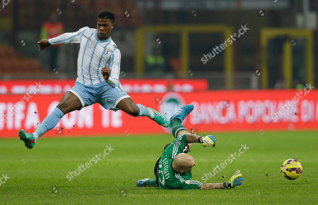 AC Milan goalkeeper Christian Abbiati, saves on an attempt to score by Lazio's Balde Diao Keita during their Italian Cup, quarterfinal match, between AC Milan and Lazio, at the San Siro stadium in Milan, Italy, Tuesday, Jan. 27, 2015