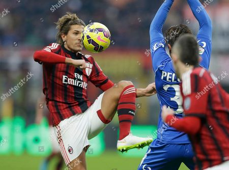 AC Milan's Alessio Cerci, left, challenges for the ball with Sassuolo midfielder Matteo Brighi during a Serie A soccer match between AC Milan and Sassuolo, at the San Siro stadium in Milan, Italy