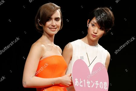 "Stock Image of Lily Collins, Ayame Goriki Actress Lily Collins, left, poses for photographers with Japanese actress Ayame Goriki during Japan premiere of her movie ""Love, Rosie"" in Tokyo"