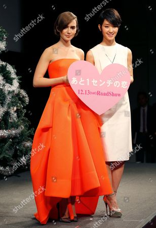 """Stock Picture of Lily Collins, Ayame Goriki Actress Lily Collins, left, poses for photographers with Japanese actress Ayame Goriki during Japan premiere of her movie """"Love, Rosie"""" in Tokyo"""